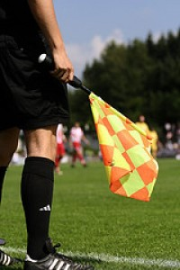 Sideline referee with flag